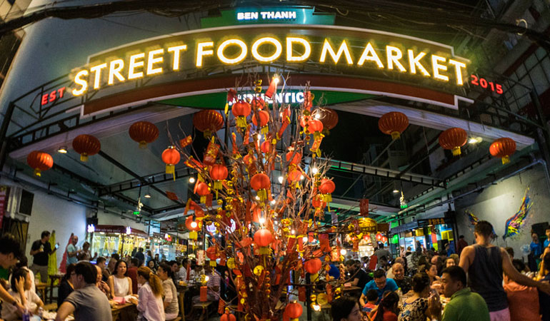 the market located on district 1s thu khoa huan street is decorated with brightly colored murals and a retractable awning overhead which can be opened brightly colored offices central st